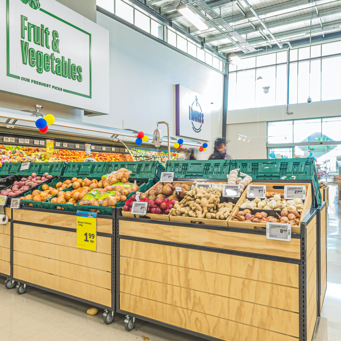 Customers take a bite from new produce fixtures.