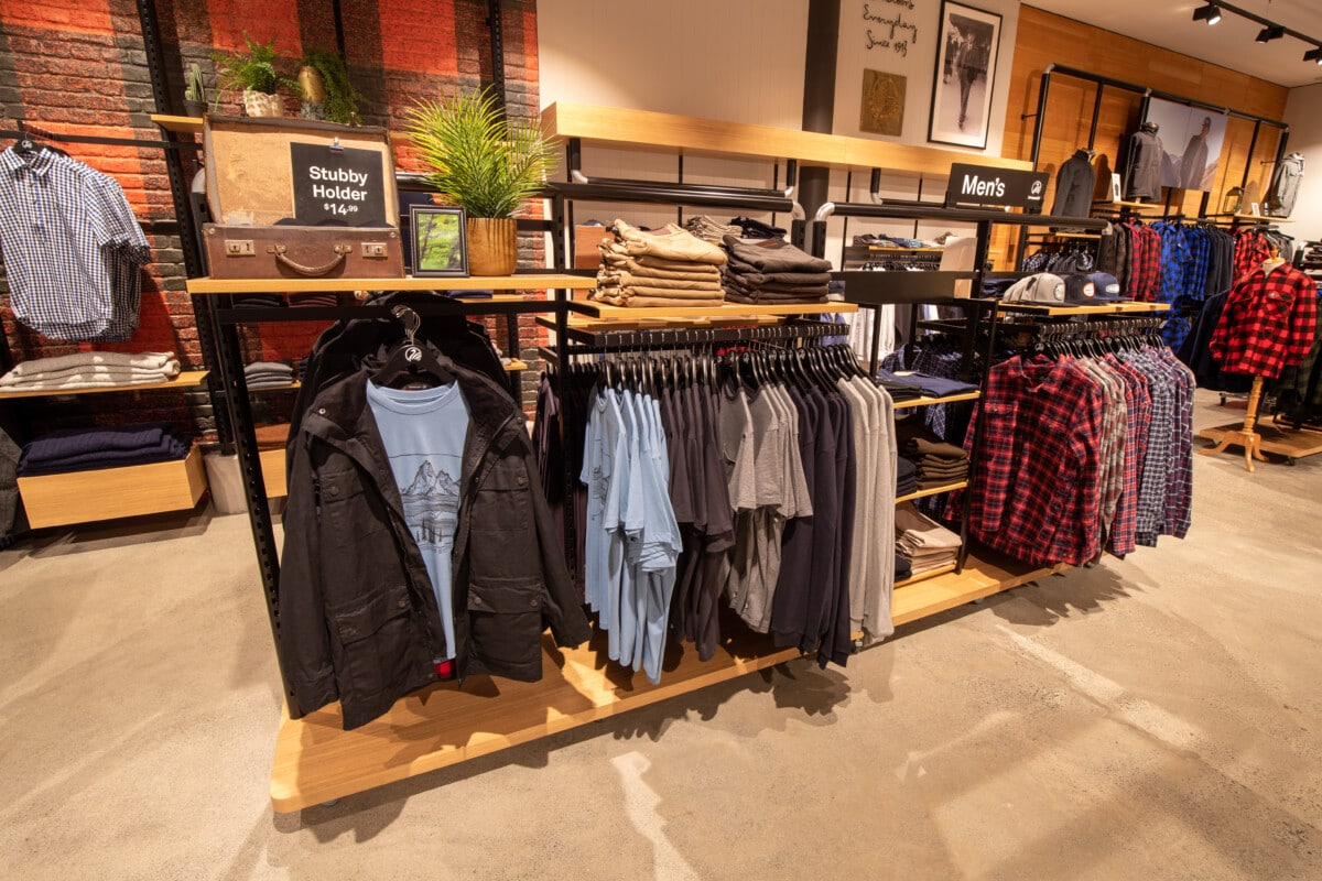 Apparel gondola with hangrails, shelves and signage