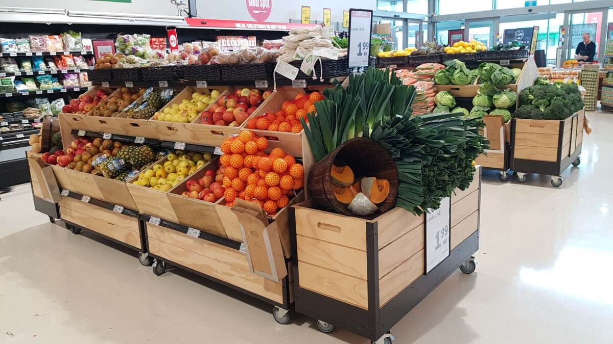 Double layer produce gondola on castors with wood crates and dumpbin end