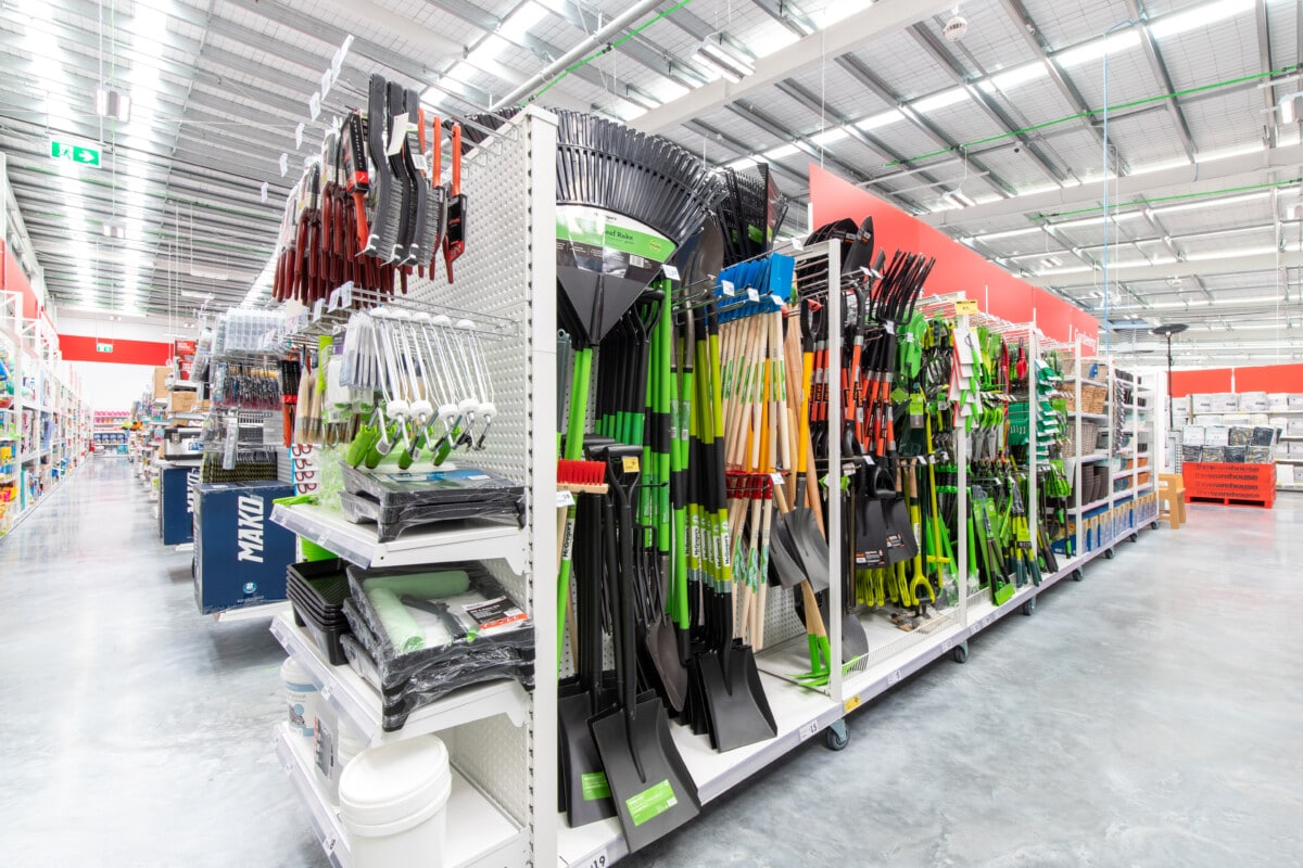 Modular gondola system with shelves, slotted panel for prongs and custom for garden tools