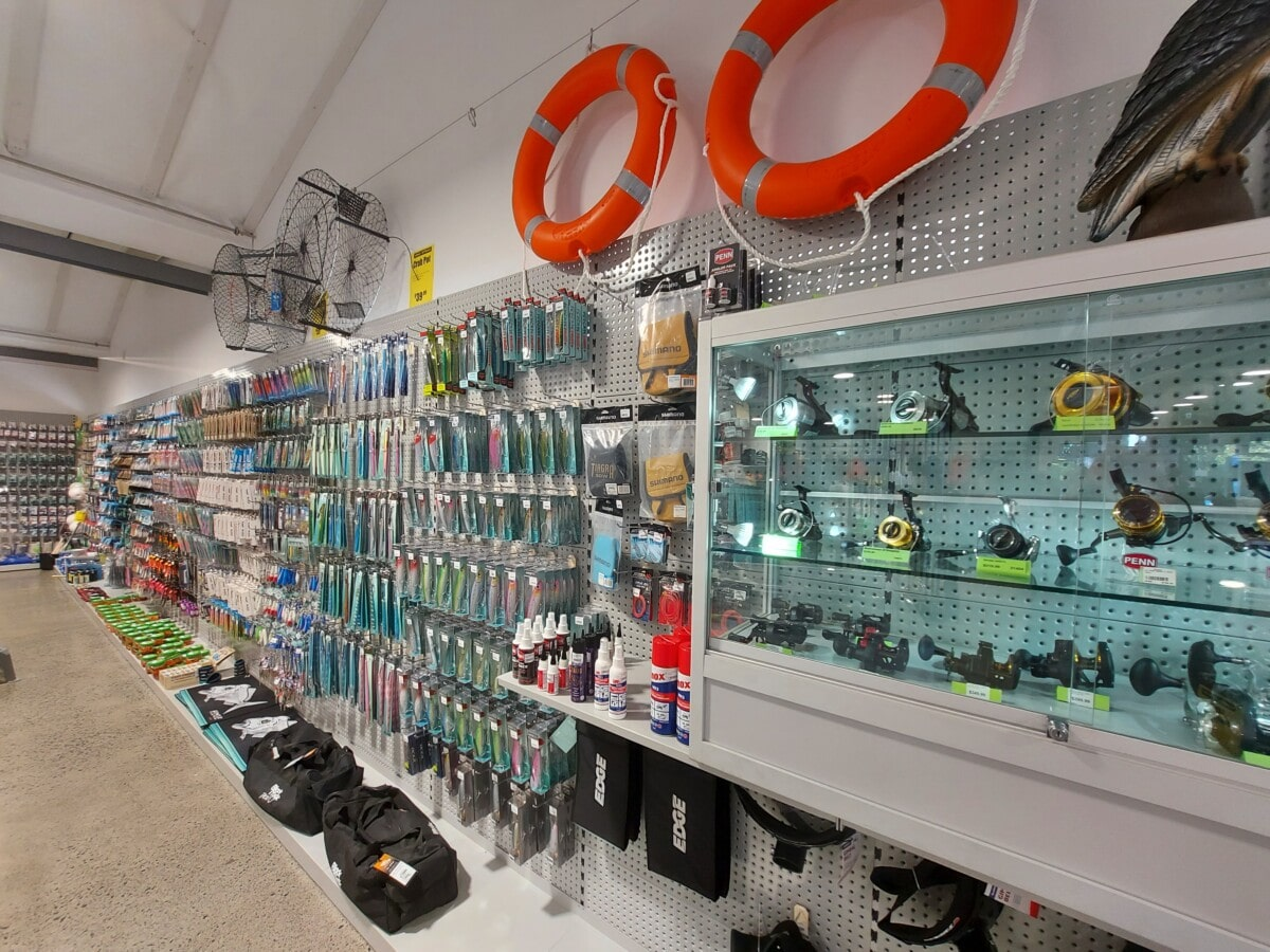Sports store glass cabinet and hangsell wall display