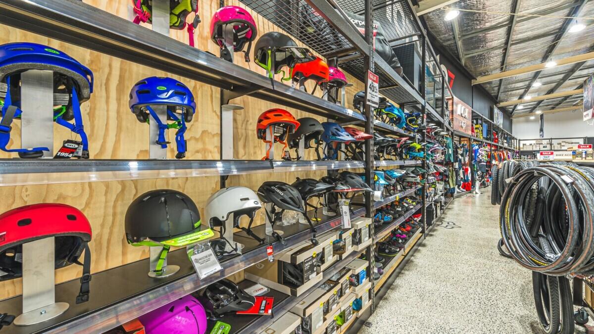 Sports helmet wall display system