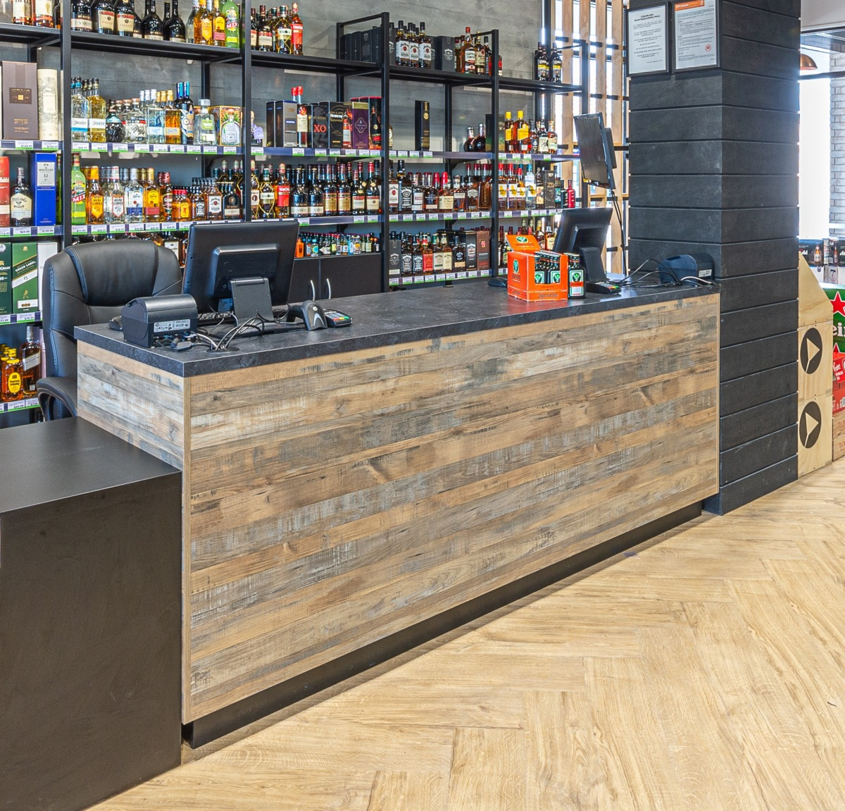 Liquor store counter with recycled wood look