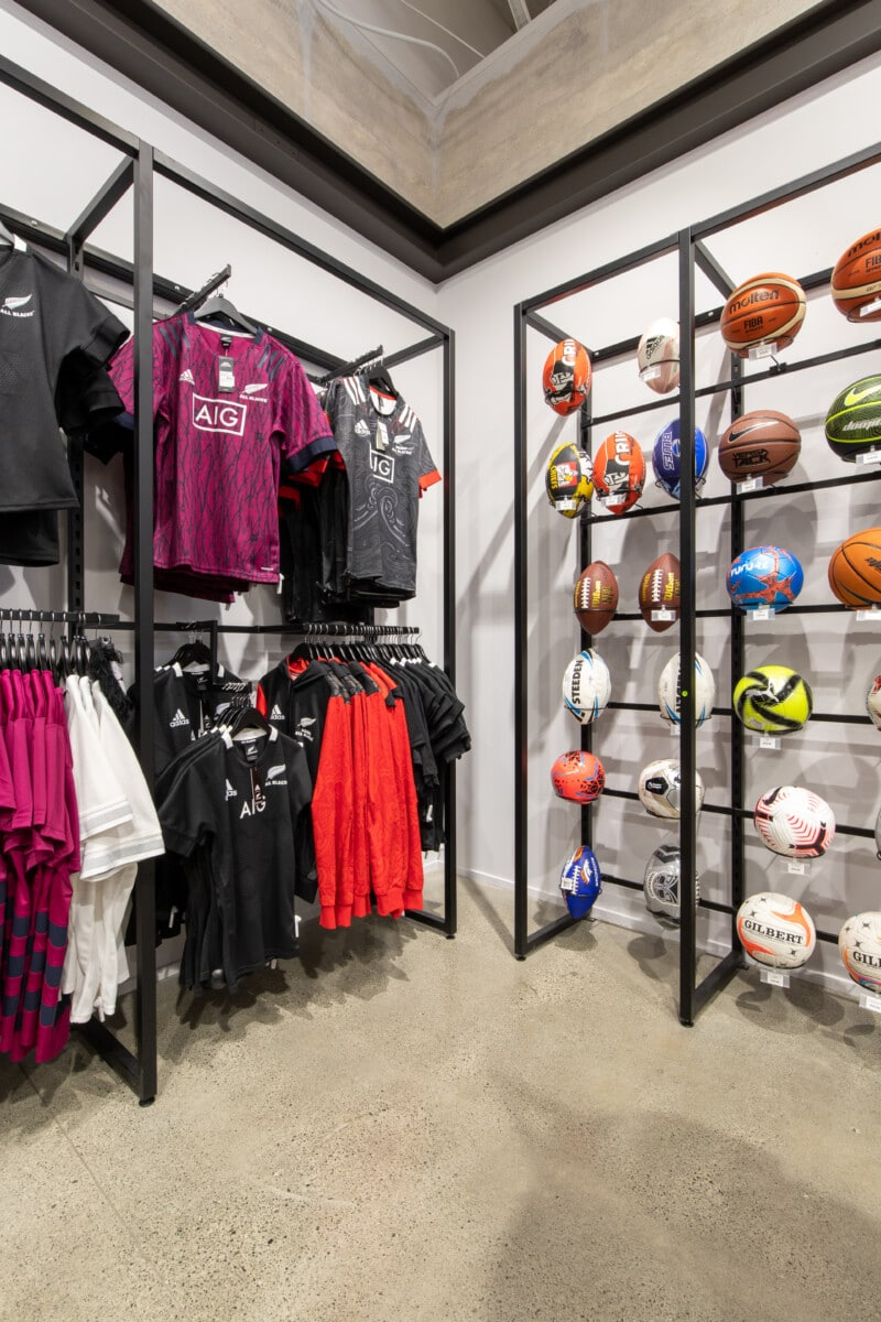 Sport store ball and apparel wall display