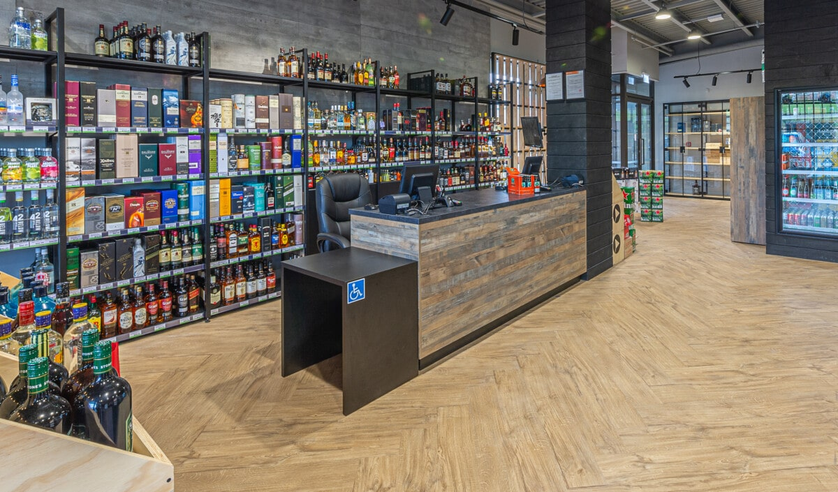 Modular liquor store wall shelving system with adjustable height and LED downlit shelves