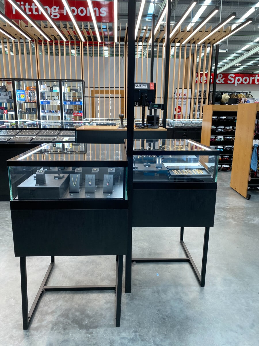 Jewellery cabinet display on pedestal with lockable glass door access sitting on a metal frame
