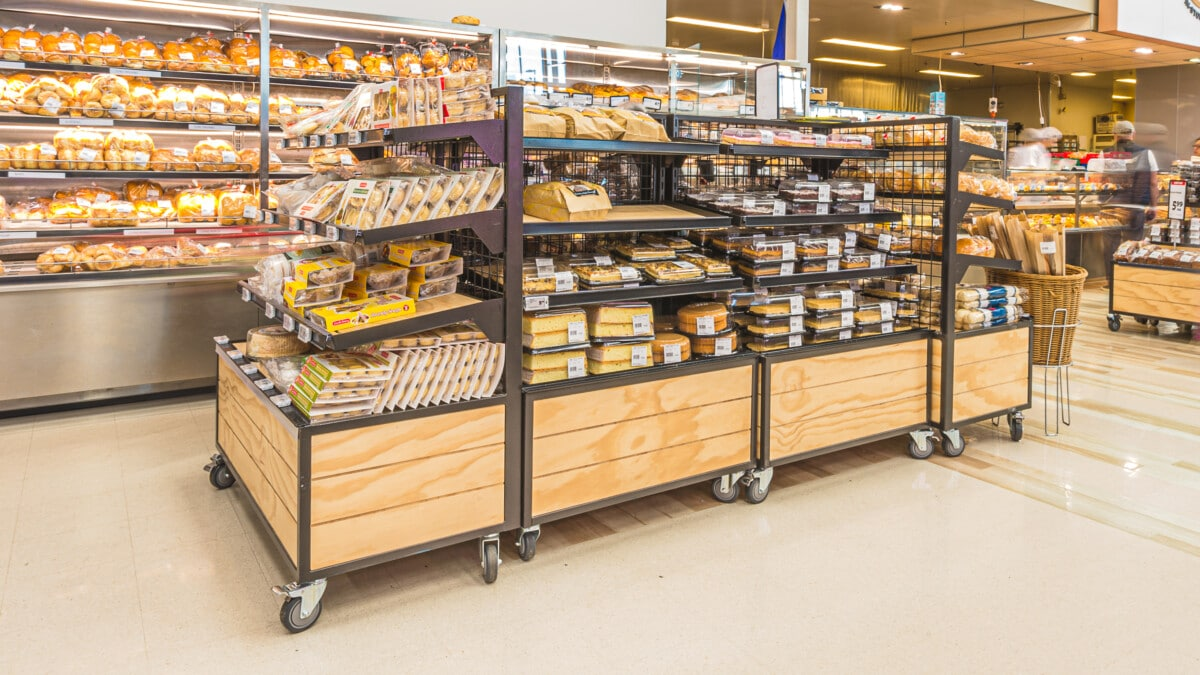 Large bakery product tables on castors with shelving and nesting table ends