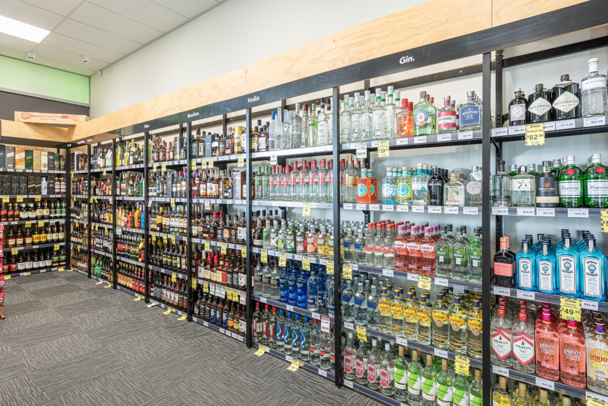 Liquor store wall shelving and category signage