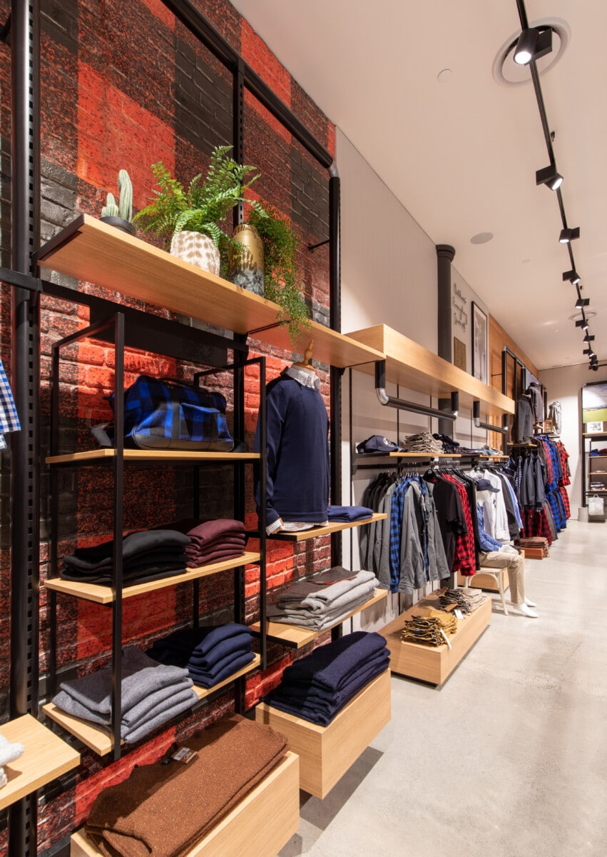 Custom wall display for apparel store made from metal pipe, frame and joinery shelving