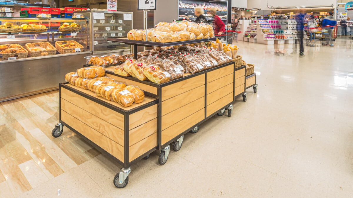 Grocery bakery tables with nesting spillover table end tables