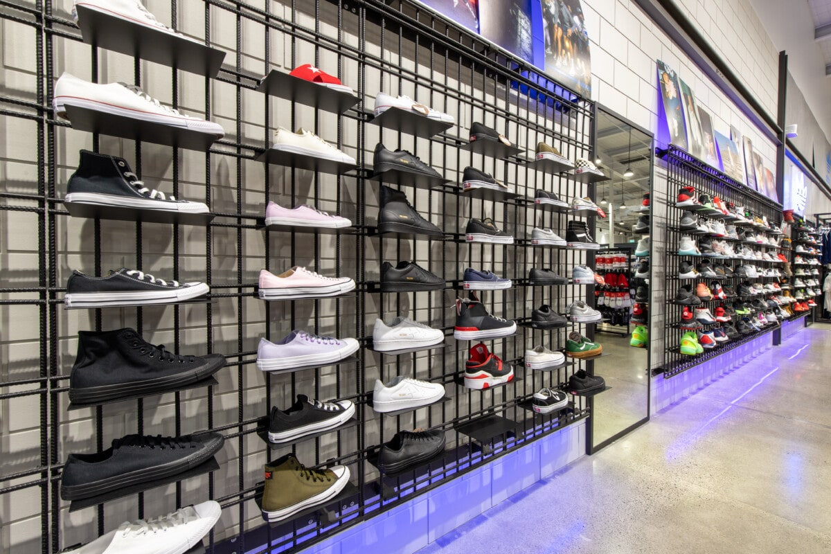 Rebar shoe display wall system with clip on metal shelves and LED lighting
