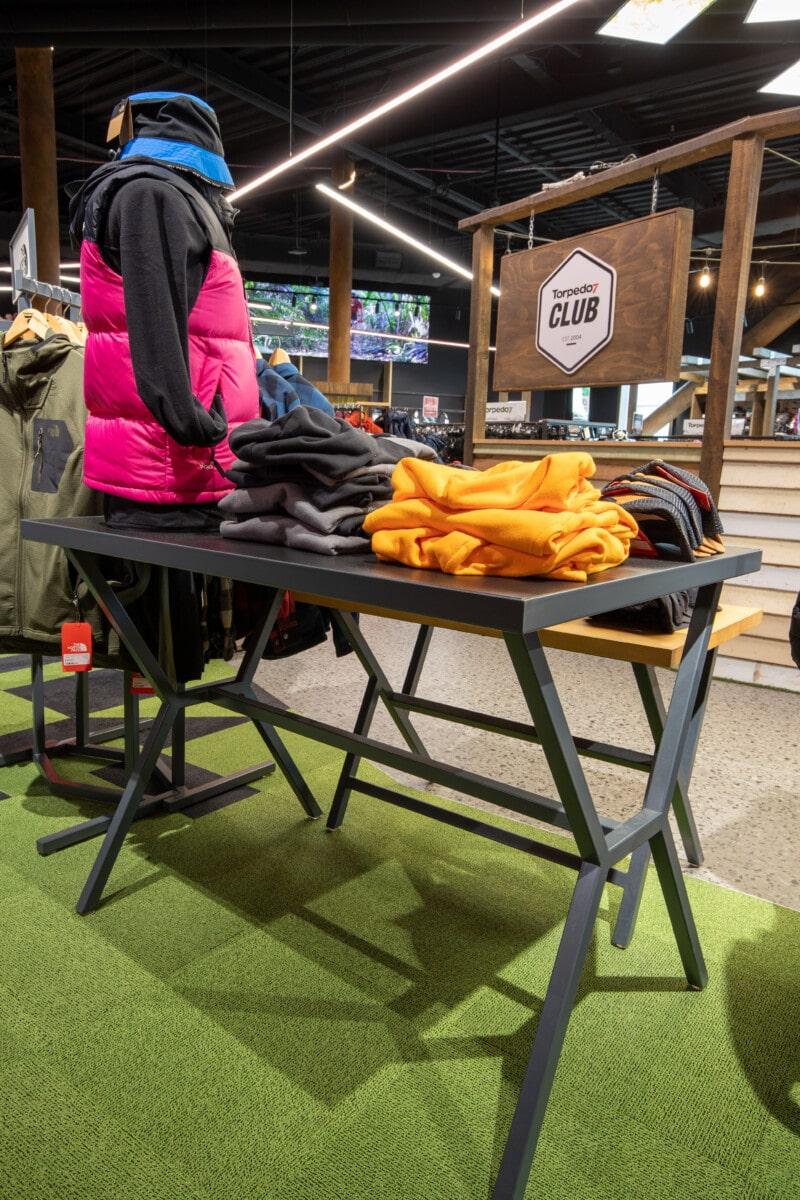 Trestle leg table for apparel goods display